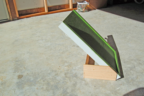 As you can see from the photo, the ramp is a modified bottom board.